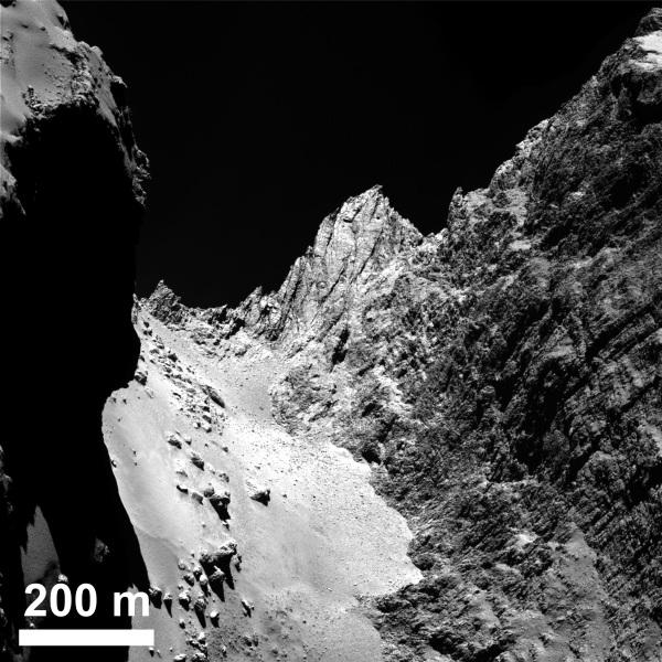 The boulder-strewn, smooth Hapi region in Comet 67P/Churyumov-Gerasimenko's neck, with the Hathor cliff face to the right. Credits: ESA/Rosetta/MPS for OSIRIS Team MPS/UPD/LAM/IAA/SSO/INTA/UPM/DASP/IDA